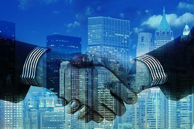 shaking hands for consulting retainers